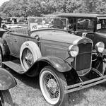 Model A Ford Cabriolet with top down.