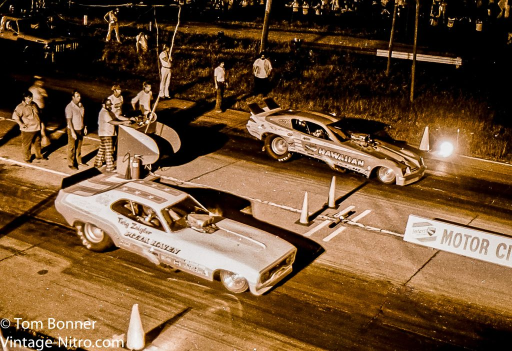 Twig Ziegker and Ron Colson square off in the final of the funny car proem at Motorcity Dragway.